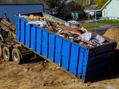 This is a picture of a 30 yard dumpster rental being rolled off onto a construction site. This picture was taken in Fort Lauderdale, Florida.